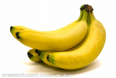 A bunch of ripe banana on a white background -...