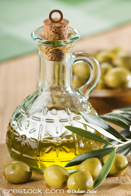extra virgin olive oil with branch close up