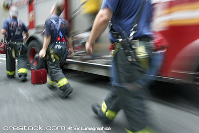 three firemen rushing on the street in motion ...