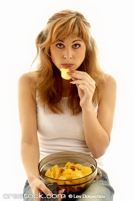 lovely girl eating potato chips