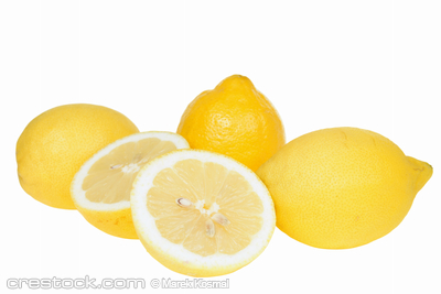 Yellow lemons close-up isolated on white backg...