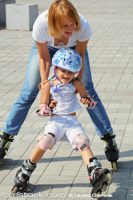 daughter and mother having fun on in-lineskate...
