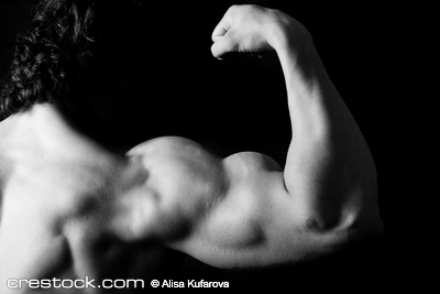 strong arm of young bodybuilder. Black and whi...