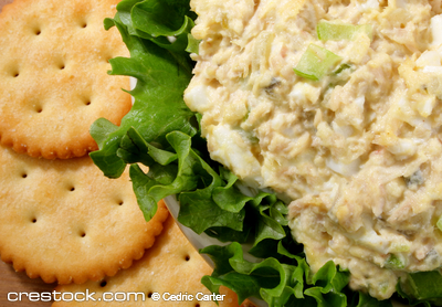 Tuna salad in a bowl with lettuce and crackers