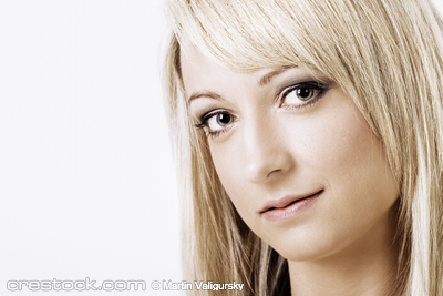 Portrait of an attractive young blond woman sm...