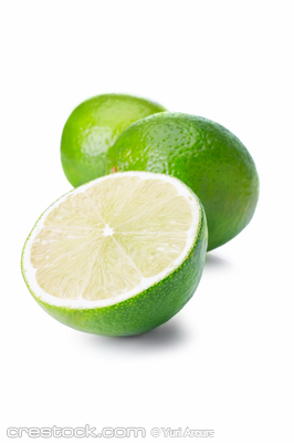 Isolated lime fruits on white background. This...
