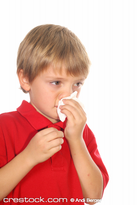 child blowing his nose