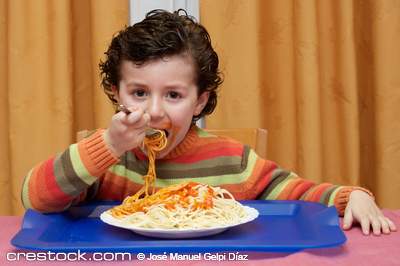 Adorable child eating in his house - focus in ...