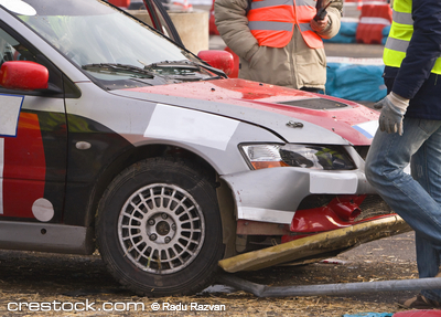 Detail of an car accident during a car race.